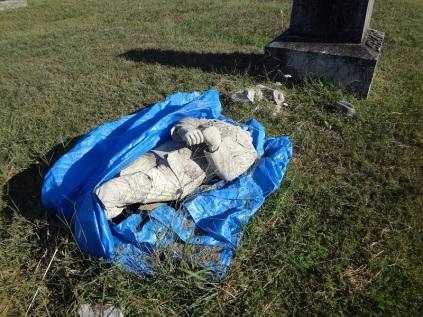 A broken grave marker in Wesley Cemetery